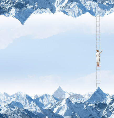 goal oriented: Businesswoman standing on ladder between two realities Stock Photo