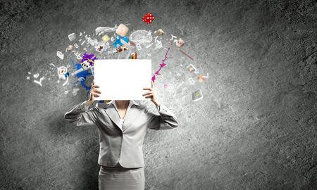 unrecognizable: Unrecognizable businesswoman holding white blank sheet of paper Stock Photo