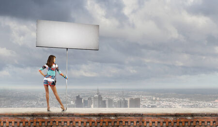 hitch hiker: Rear view of woman in short dress with blank banner