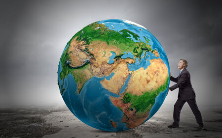 Businessman pushing big Earth planet. Elements of this image are furnished by NASA photo