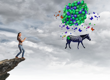 positivism: Young woman in casual and zebra on lead Stock Photo