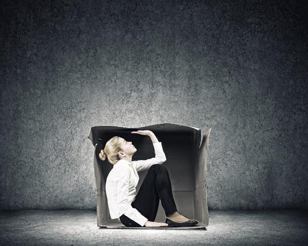 Young businesswoman trapped in carton box Banco de Imagens - 32702860