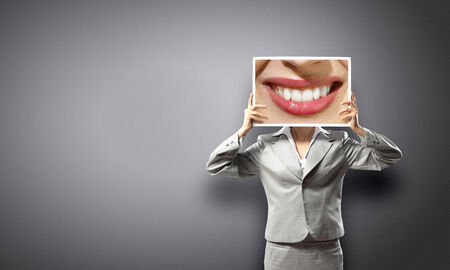 Unrecognizable businesswoman holding big photo with lips photo