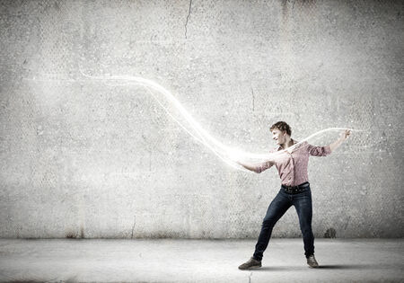 supernatural power: Young man in casual throwing magic light