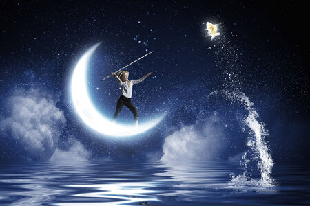 Cute girl fisherman throwing harpoon to catch gold fish photo