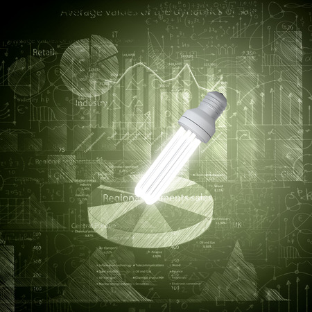 Glowing light bulb with sketches at background photo