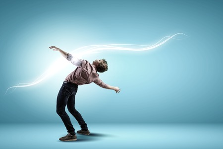 Young guy in casual evading from light rays Stock Photo