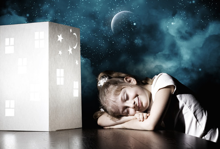 sweet dreams: Little cute girl in darkness dreaming about home and family