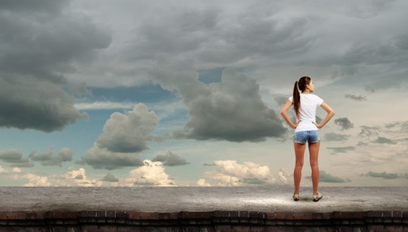 Rear view of young girl in denim shorts photo