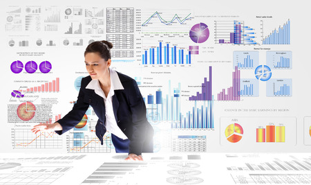 financial data: Young businesswoman and statistics information on table