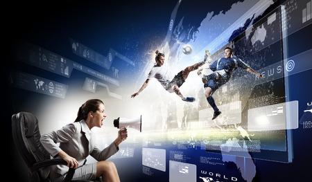 Emotional woman watching football match on 3 d tv photo