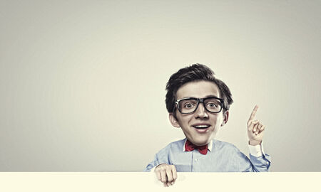 gladness: Young funny man with big head holding banner Stock Photo
