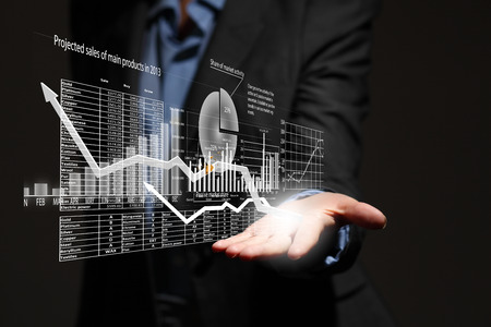 Close up of businesswoman holding graphs in hand Stockfoto