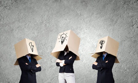 Unrecognizable business people with carton boxes on head photo