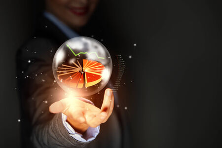 Close up of businesswoman holding graphs in hand photo