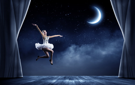 dancing girl: Young girl dancer jumping high in sky Stock Photo