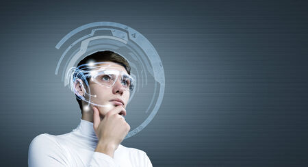 futuristic man: Young man wearing futuristic glasses against blue background Stock Photo