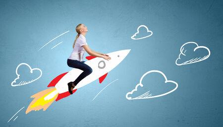 背景に描かれたロケットの飛行少女 写真素材