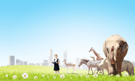 Cute school girl outdoor with wild animals photo