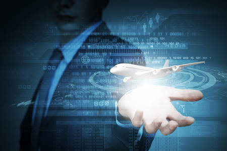 Close up of businessman at digital background with airplane in palm photo