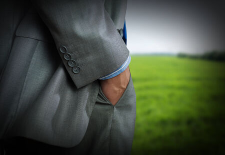 market bottom: Bottom view of businessman with hands in pockets Stock Photo