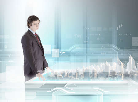 Young businessman examining model of construction project photo