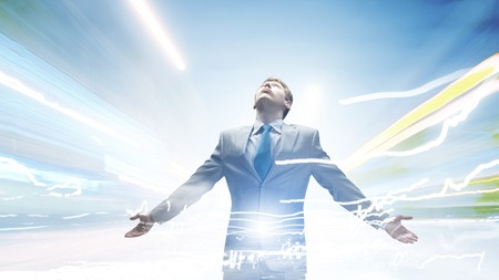 outstretched arms: Joyful businessman with outstretched arms celebrating success Stock Photo