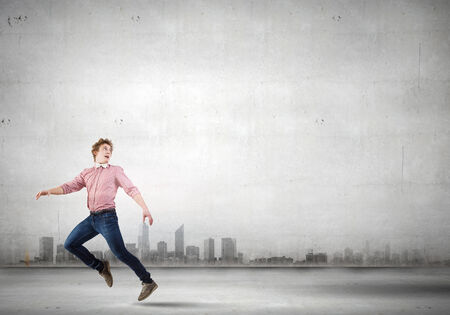 run out: Young man in casual running away from something