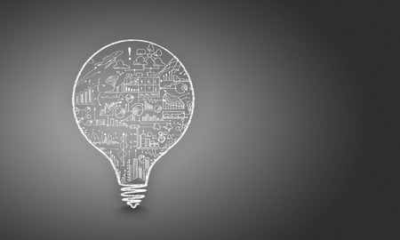 Conceptual image with light bulb filled with business sketches