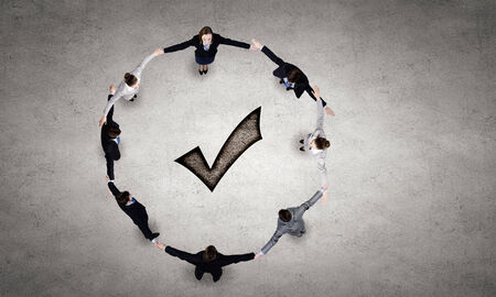 intelligent partnership: Group of business people standing in circle Stock Photo