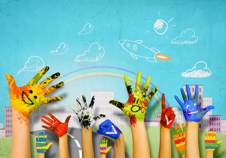 crafts person: Human hands in colorful paint showing symbols Stock Photo
