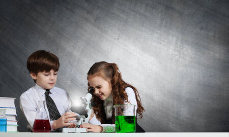 chemistry lesson: Two cute children at chemistry lesson making experiments
