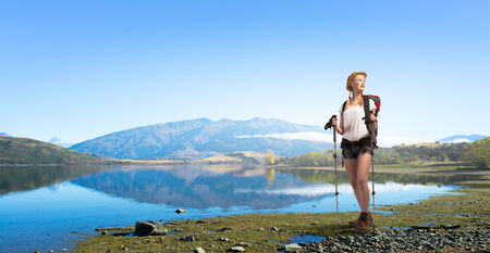 woman hiking: Young pretty girl tourist with backpack on back hiking at summer Stock Photo