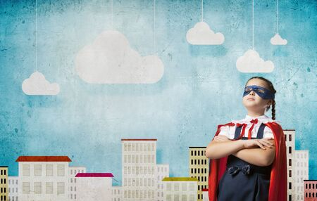 Girl of school age in super hero costume Stock Photo