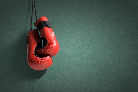 Pair of boxing gloves hanging on all Stock Photo