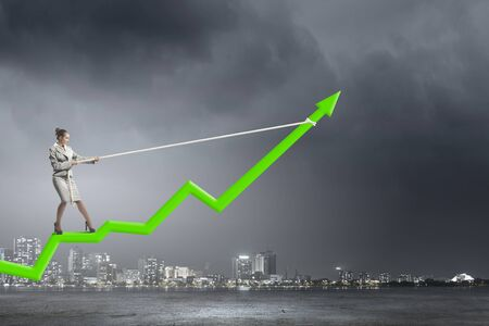 raise: Businesswoman pulling arrow with rope and making it raise up