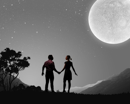adoration: Silhouettes of young romantic couple standing under the moon light Stock Photo
