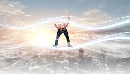 supernatural power: Young guy in casual evading from light rays Stock Photo