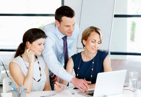 working together: Team of business people working together Stock Photo