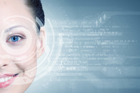 cyber woman: Close up of woman eye with digital icons Stock Photo