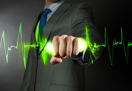 cardiograph: Close up of businessman grasping cardiograph in fist