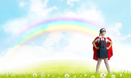 triumphant: Girl of school age in super hero costume Stock Photo