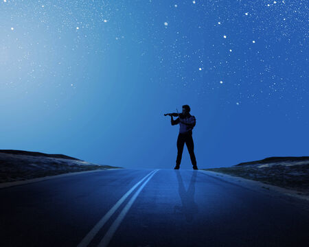 man in the moon: Young man playing violin at night under moon light Stock Photo