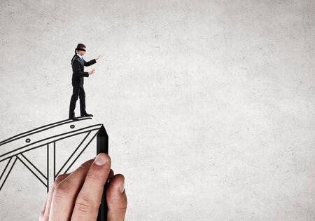 blindfold: Businessman in blindfold walking on drawn bridge over gap