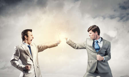 furious: Two furious businessman fighting with each other