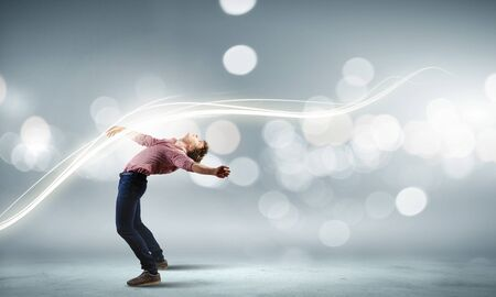 matrix: Young guy in casual evading from light rays Stock Photo