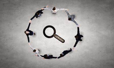 Group of business people standing in circle photo