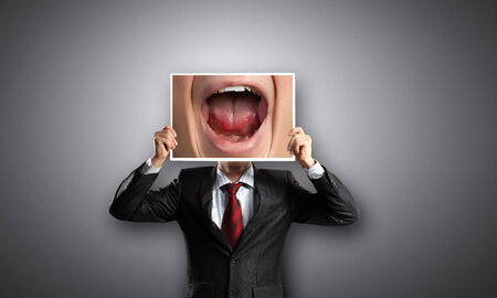 malice: Unrecognizable businessman holding photo with screaming mouth