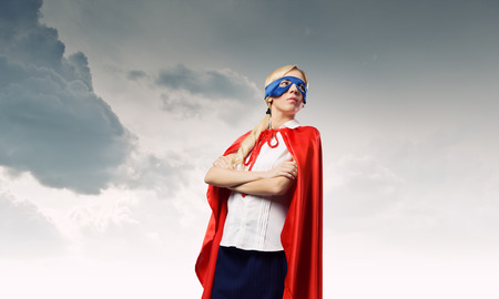 super power: Young confident woman in super hero costume