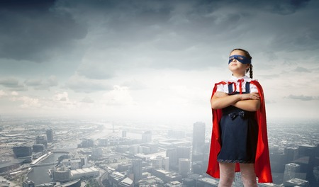 super human: Girl of school age in super hero costume Stock Photo